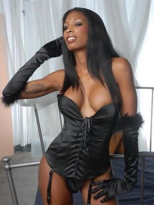 Black t-girl shows her massive boobies & ass