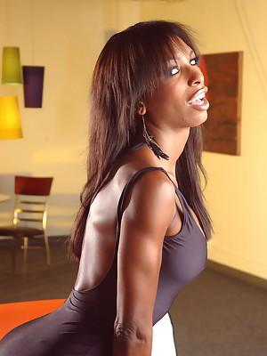 Chocolate Natassia posing in her seductive brown dress